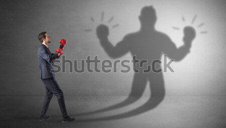 Businessman with toreador concept and his shadow on the backgrou Stock photo © ra2studio