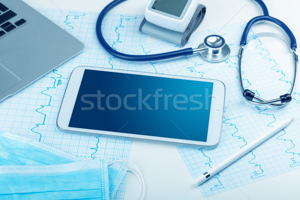 Medicine and modern technology concept with copyspace on tablet Stock photo © ra2studio