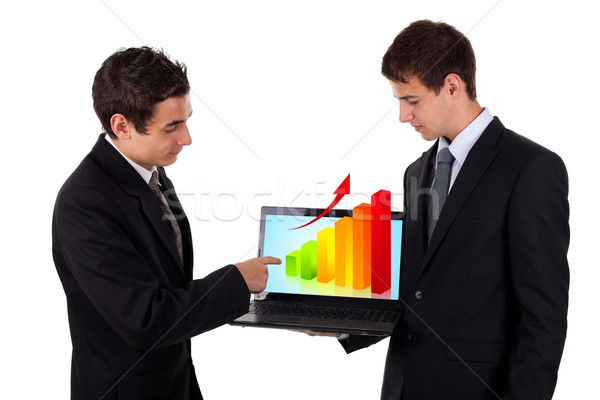 business man show on laptop with chart 2 Stock photo © ra2studio