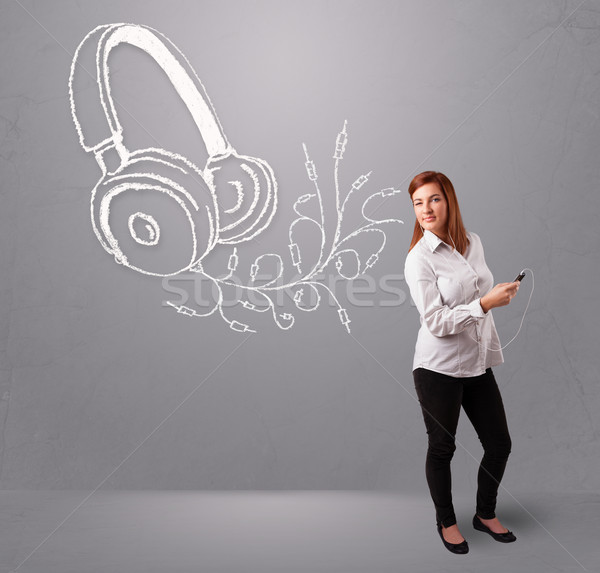 young woman singing and listening to music with abstract headphone Stock photo © ra2studio