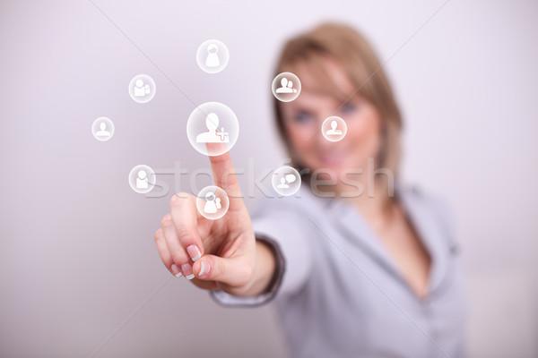 Woman pressing social add friend button Stock photo © ra2studio