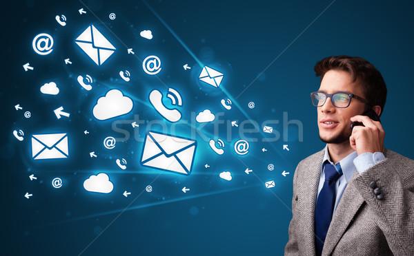 Fiatalember készít telefonbeszélgetés üzenet ikonok telefon Stock fotó © ra2studio