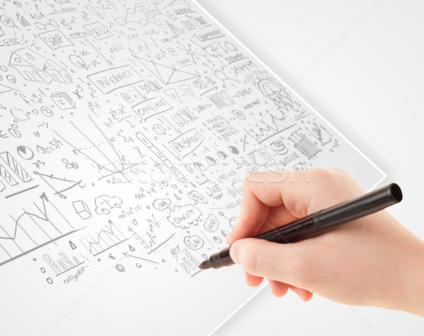 Human hand sketching ideas on a white paper Stock photo © ra2studio