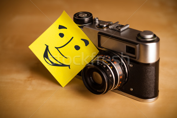 Post-it note with smiley face sticked on a photo camera Stock photo © ra2studio