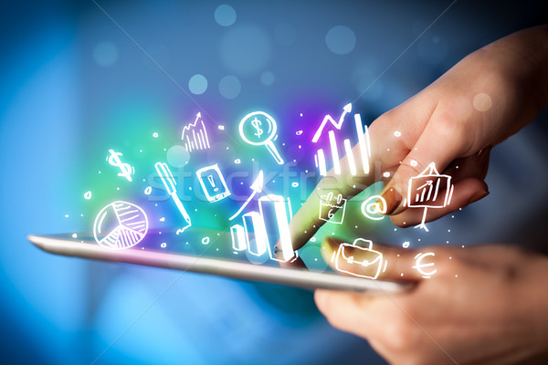 Hand touching tablet pc, charts concept Stock photo © ra2studio
