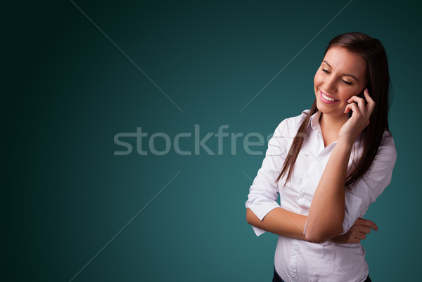 Young woman making phone call with copy space Stock photo © ra2studio