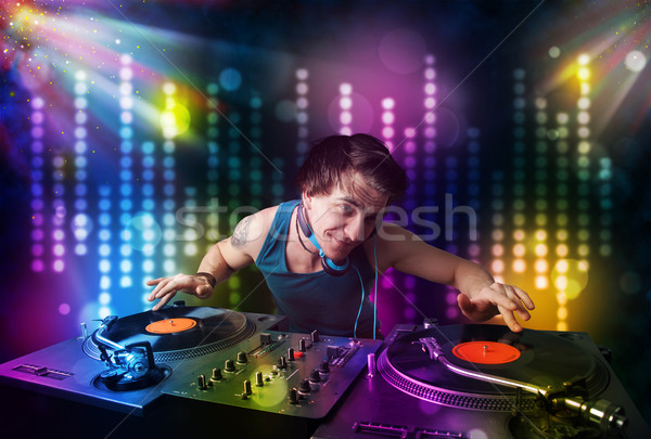 Dj playing songs in a disco with light show Stock photo © ra2studio
