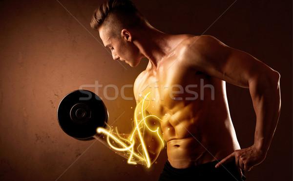 Corpo musculoso construtor peso energia luzes Foto stock © ra2studio