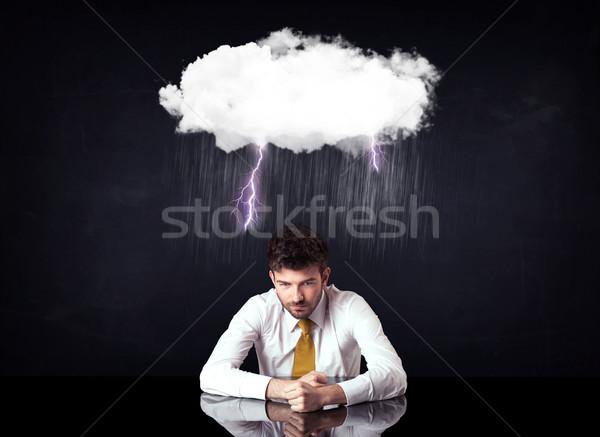 Lehangolt üzletember ül felhő villám esős Stock fotó © ra2studio
