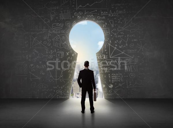 üzletember néz kulcslyuk fényes városkép üzlet Stock fotó © ra2studio