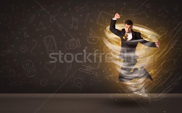 Feliz empresário saltando tornado marrom homem Foto stock © ra2studio