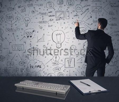 бизнесмен Дать стратегия плана стены интеллектуальный Сток-фото © ra2studio