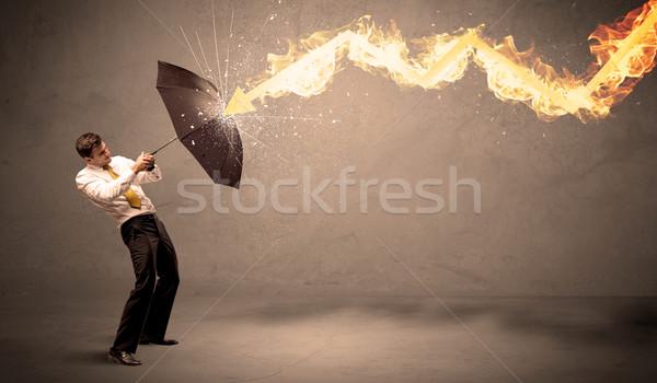 Iş adamı yangın ok şemsiye yağmur Stok fotoğraf © ra2studio