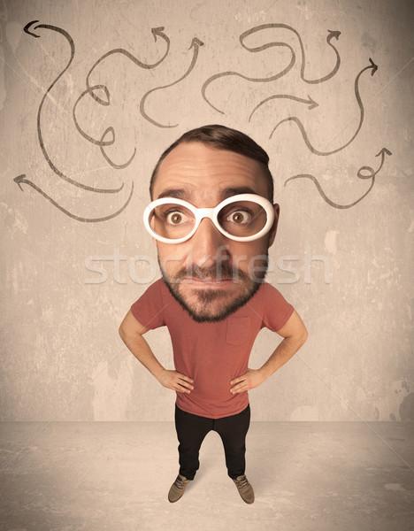 Big head person with arrows Stock photo © ra2studio
