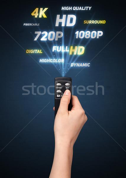 Hand afstandsbediening multimedia uit technologie Stockfoto © ra2studio