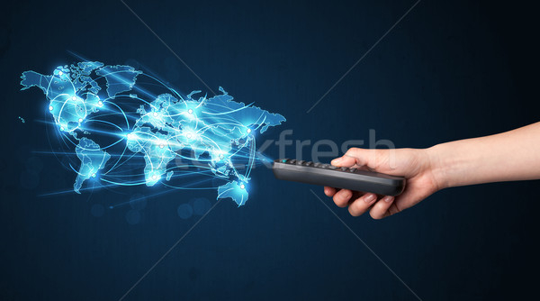 Hand with remote control, social media concept Stock photo © ra2studio
