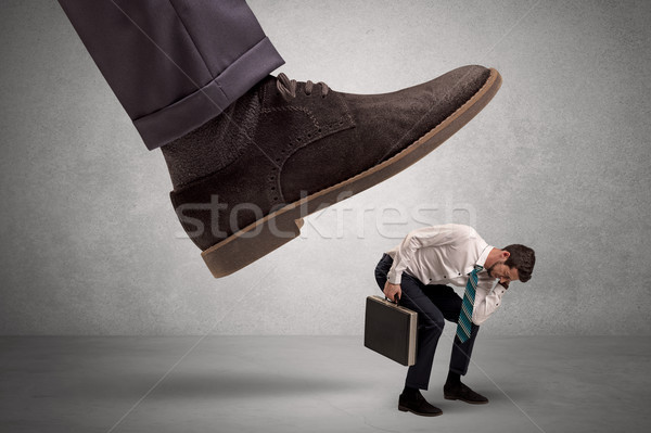 Employee afraid of the big boss foot Stock photo © ra2studio
