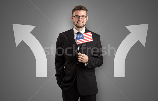 Stock photo: Handsome boy choosing target country