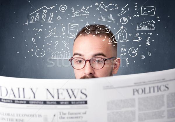 Businessman reading newspaper Stock photo © ra2studio