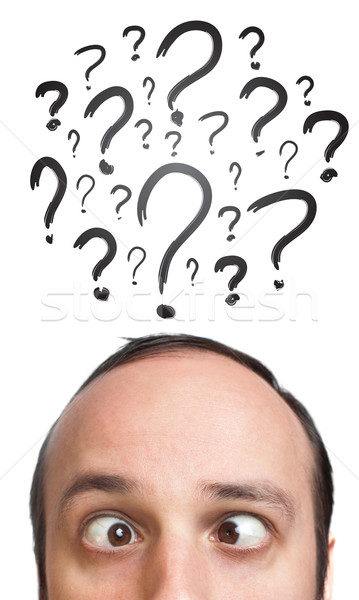 Caucasian male adult has way too many questions in his head Stock photo © ra2studio