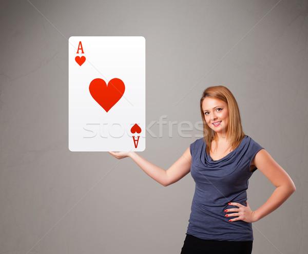 Nő tart piros szív ász fiatal nő Stock fotó © ra2studio