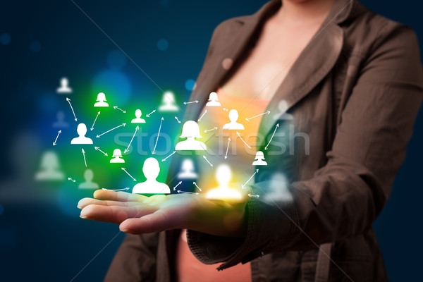 Young woman presenting modern technology social network map Stock photo © ra2studio