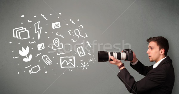 Photographer boy capturing white photography icons and symbols Stock photo © ra2studio