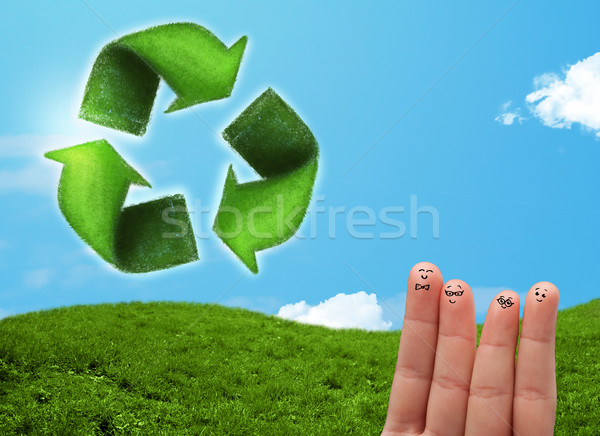 Happy smiley fingers looking at green leaf recycle sign Stock photo © ra2studio