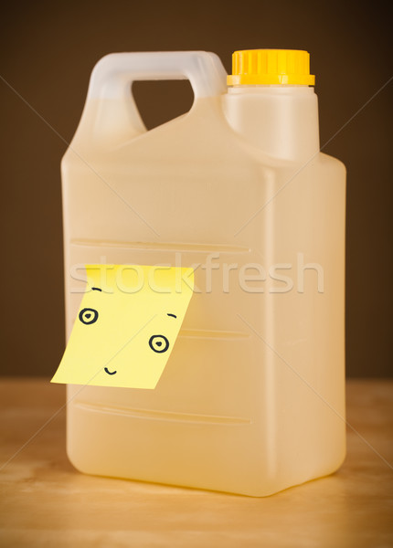 Post-it note with smiley face sticked on a gallon Stock photo © ra2studio