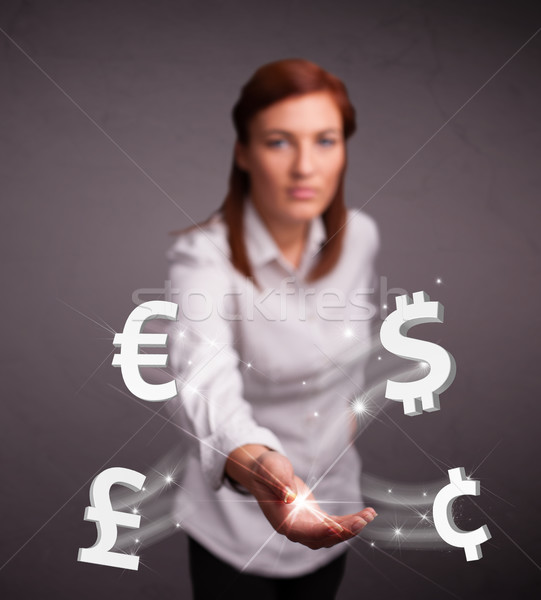 Young lady throwing currency icons Stock photo © ra2studio