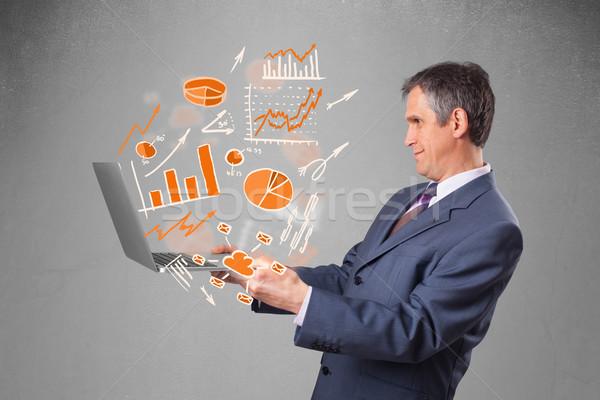 бизнесмен ноутбук статистика костюм Сток-фото © ra2studio