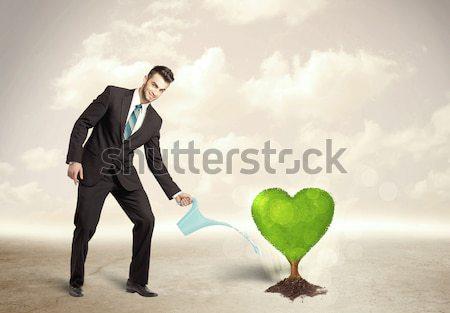 Businessman on rock mountain with a tree Stock photo © ra2studio