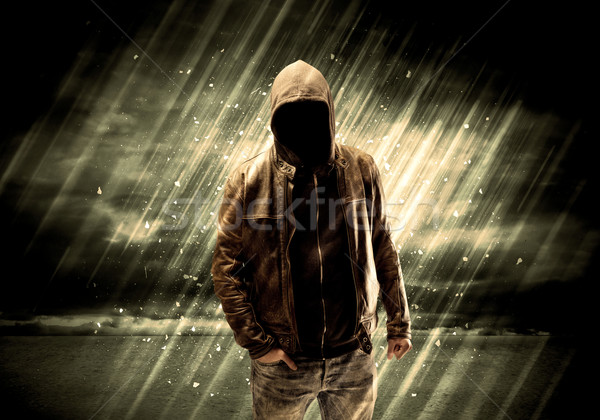 Stock photo: Dangerous criminal standing with cigarette