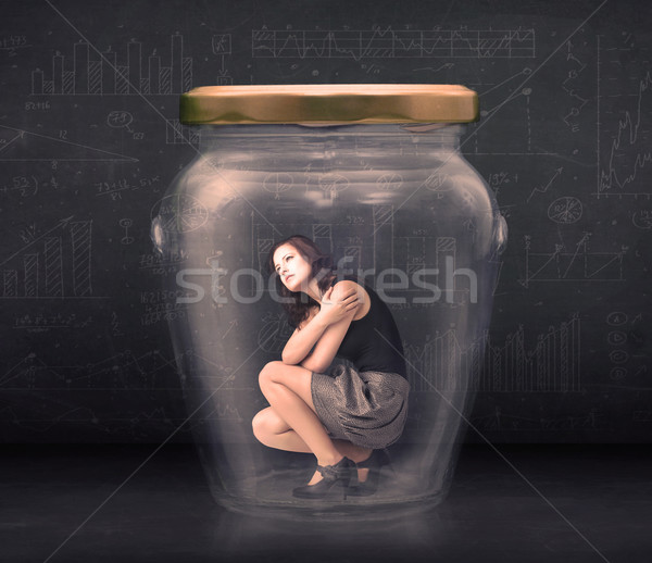 Stock photo: Businesswoman shut inside a glass jar concept