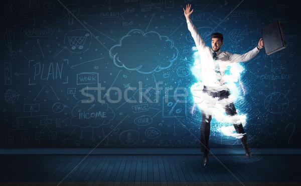 Szczęśliwy człowiek biznesu skoki burzy Chmura około Zdjęcia stock © ra2studio