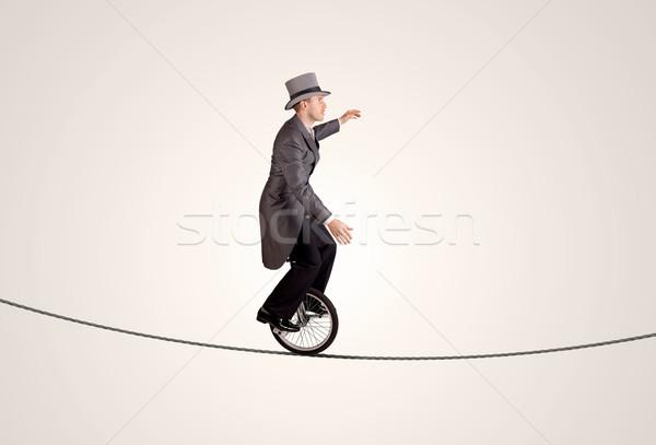 極端な ビジネスマン ライディング 一輪車 ロープ ビジネス ストックフォト © ra2studio