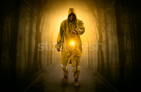 Mysterious man coming from a path in the forest with glowing lan Stock photo © ra2studio