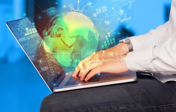 Hand using laptop  with worldwide reports links and statistics c Stock photo © ra2studio