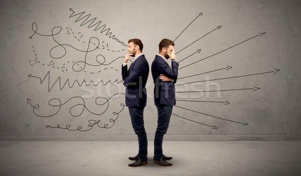 Businessman with two choices Stock photo © ra2studio