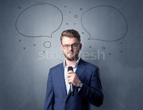 Businessman holding microphone Stock photo © ra2studio