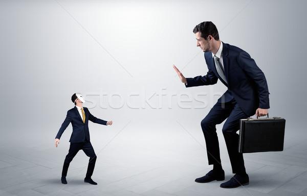 Konfliktus kicsi nagy üzletember elegáns üzlet Stock fotó © ra2studio