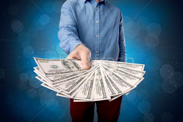 Empresario dinero jóvenes grande cantidad Foto stock © ra2studio