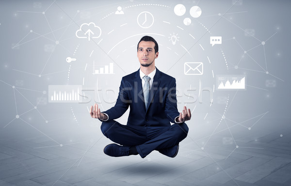 Stock photo: Businessman levitates with data circulation concept