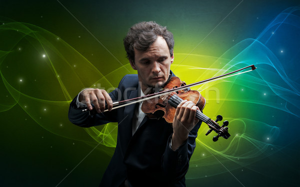 Violinist with colorful fabled concept Stock photo © ra2studio