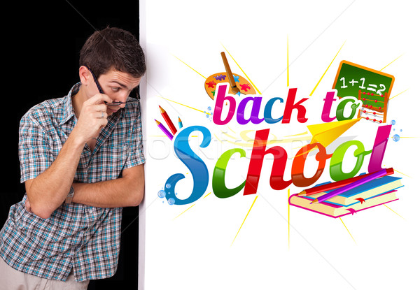 Student looking at back to school sign Stock photo © ra2studio