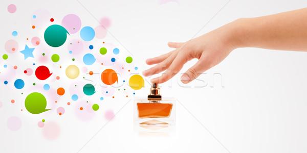 Kobieta ręce kolorowy pęcherzyki piękna Zdjęcia stock © ra2studio
