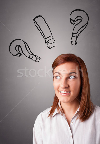 Stock photo: Young lady thinking with question marks overhead