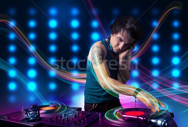 Jovem registros colorido luzes atraente festa Foto stock © ra2studio