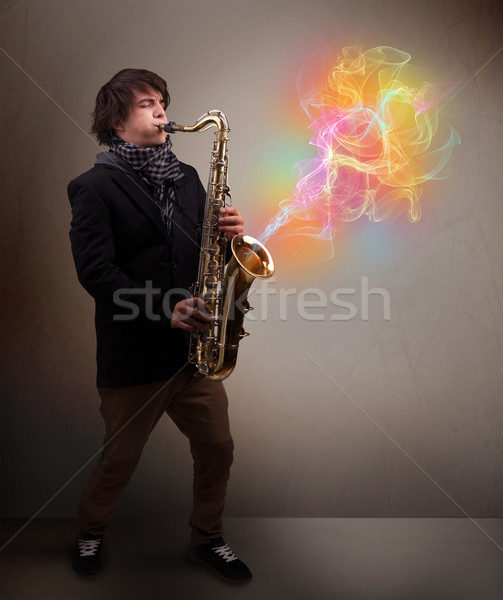 Attractive musician playing on saxophone with colorful abstract  Stock photo © ra2studio