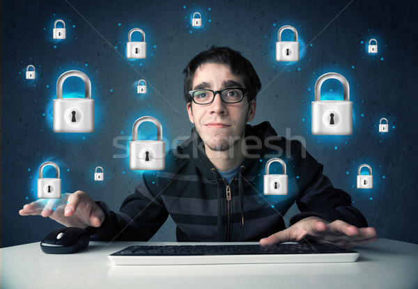 Young hacker with virtual lock symbols and icons Stock photo © ra2studio